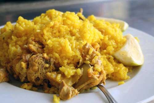 como preparar arroz con costillas